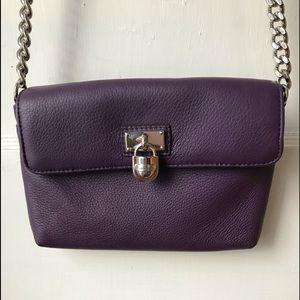 Small purple handbag